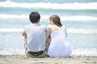 Couples snuggle on the beach Stock photo [1987103] Couple