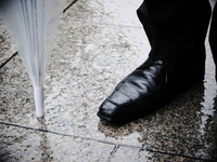 Plastic umbrella and wet shoes Stock photo [2096349] Shoes