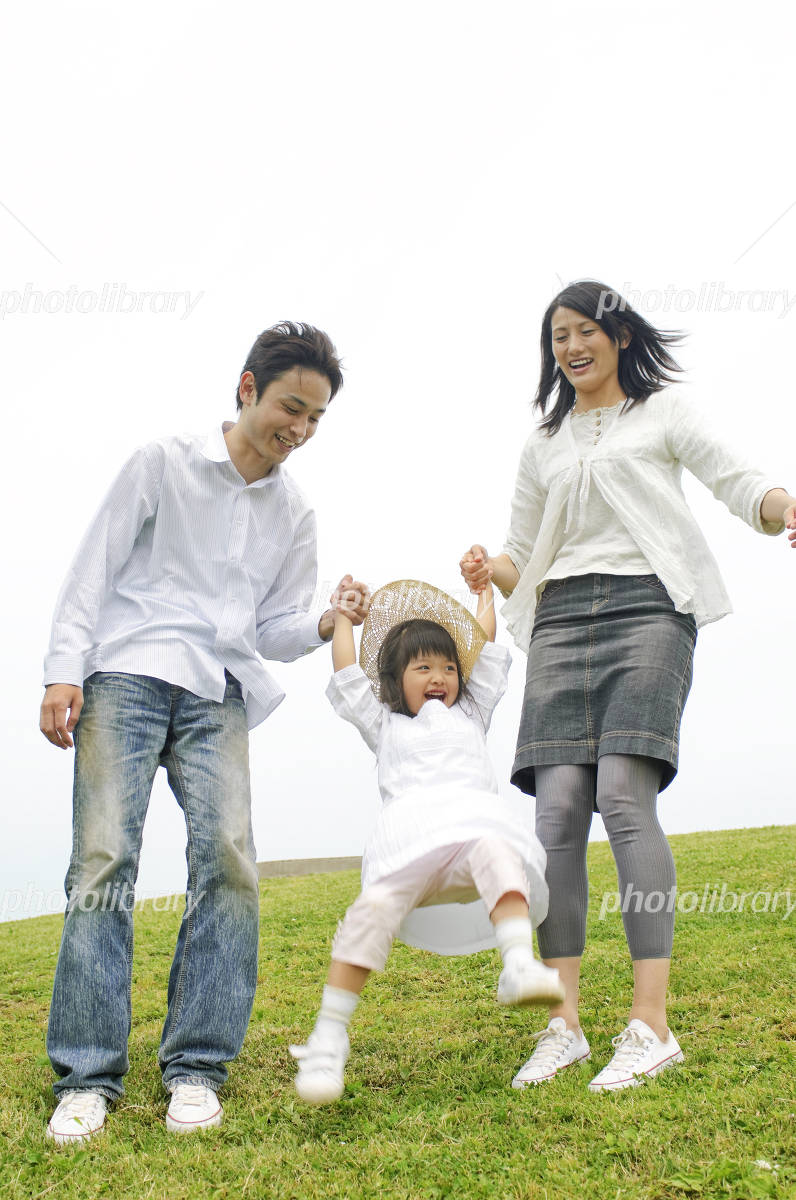 Family walking on top of the hill Photo
