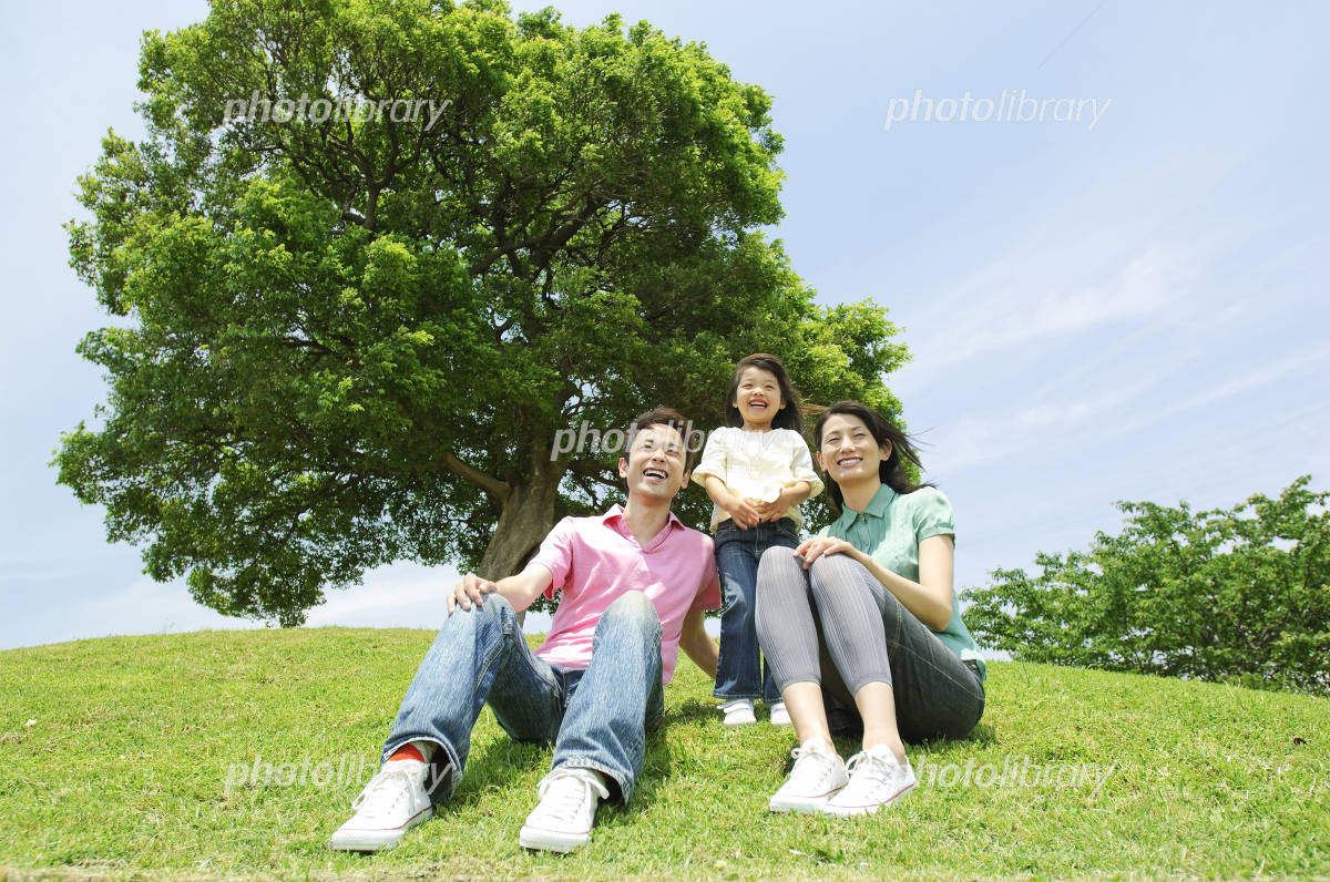 Family sitting in the hills Photo