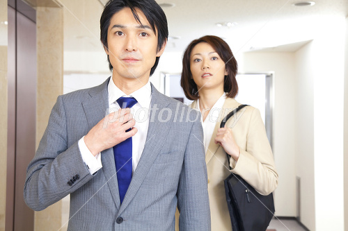 Businessman and OL walking down the hall Photo