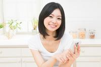 Kitchen woman smartphone Stock photo [2318129] Smartphone