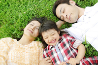 Family that plops itself down on his back in the park Stock photo [2319108] Three