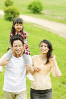 Mother to walk buckwheat and father to piggyback a daughter Stock photo [2319111] Three