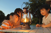 Mother and siblings to stare at the light of lanterns Stock photo [2319169] Mom