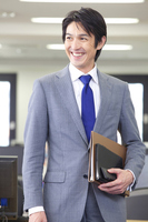 Businessman walking in the office with a notebook Stock photo [2322281] People