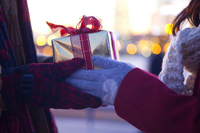 Hand of woman to pass a Christmas gift to men Stock photo [2322682] December