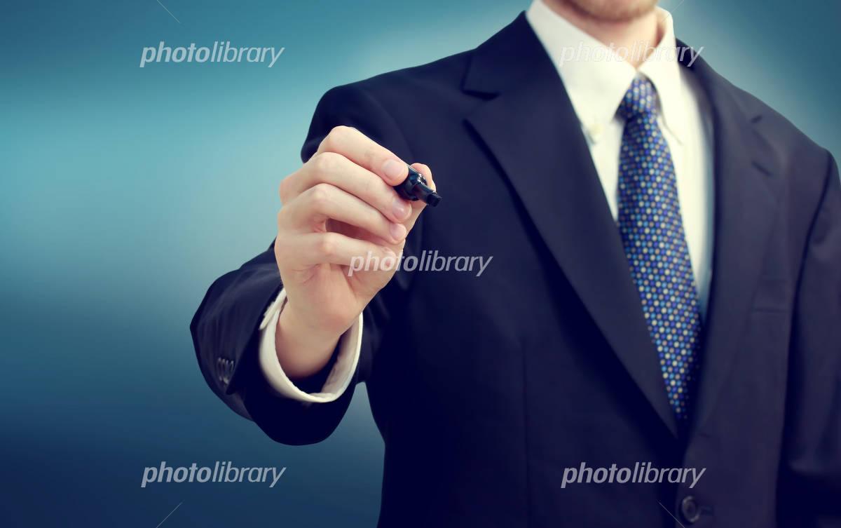 Businessman and pen Photo