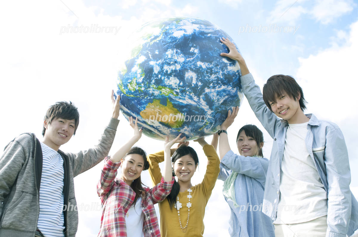 Young people with the Earth's ball Photo