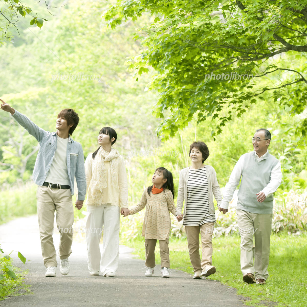 Holding Hands in fresh green 3 generation family Photo