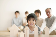 Boy playing with building blocks and Family Stock photo [2442617] Person