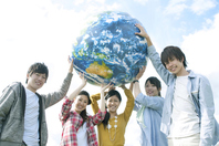 Young people with the Earth's ball Stock photo [2443045] Person