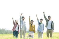 Young people cite one hand in grassland Stock photo [2443072] Person