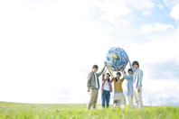 Young people with the Earth's ball in grassland Stock photo [2443125] Person