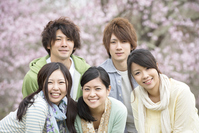 Young people who smile in front of Sakura Stock photo [2446838] Person