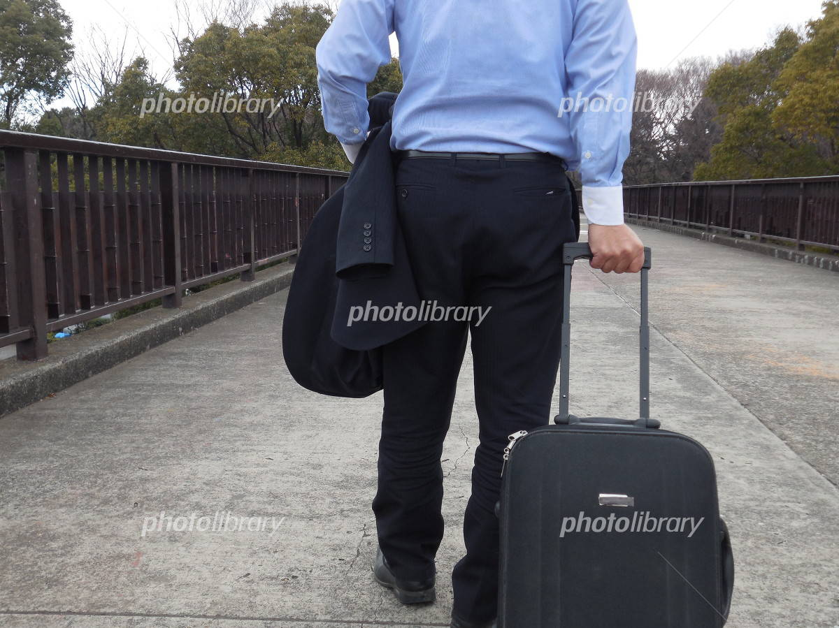 Businessman catching carry back Photo