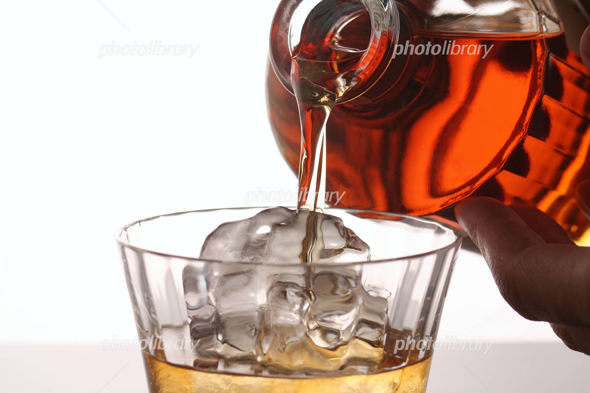 Up pouring whiskey into a glass Photo