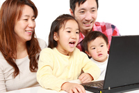 Four family of Japanese to enjoy the Internet Stock photo [2928032] Family