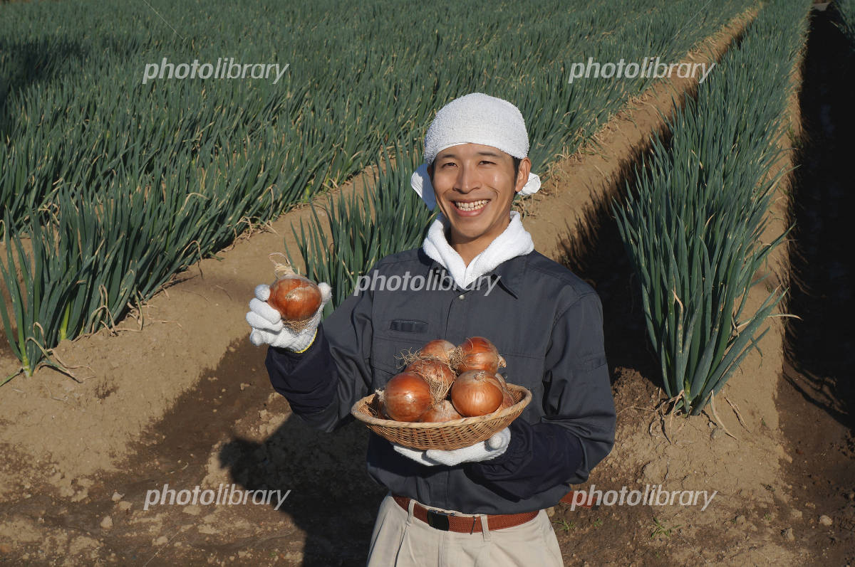 Men with onions colander Photo