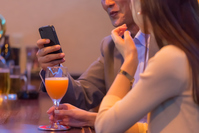 Couple to operate the smartphone at the bar counter Stock photo [4003327] Bar