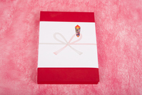 Red box of gifts with a gift wrapping paper Stock photo [4094769] Works