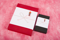 Red and black box of gifts with a gift wrapping paper Stock photo [4094773] Works