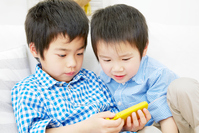 Brothers to use the smart phone in the room Stock photo [4692540] Brother