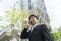 Businessman talks on outdoor smartphone Stock photo [5052040] smartphone