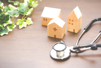 Stethoscope and house A