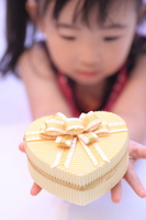 Girl handing a gift Stock photo [834189] Girls