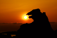 Godzilla rock to kiss and sunset Stock photo [2001822] Sunset