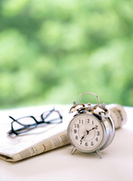Alarm clock and newspapers and glasses Stock photo [2855214] Alarm