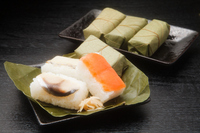 Persimmon leaf sushi stock photo