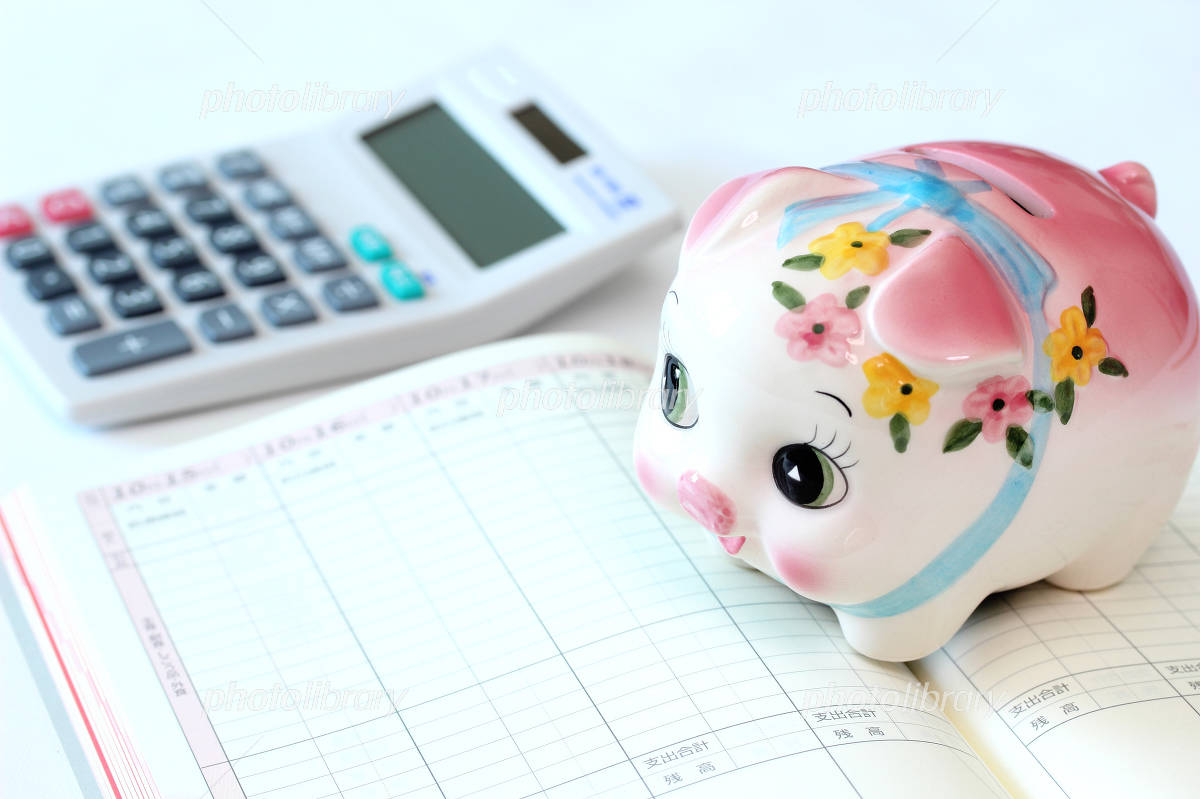 Piggy bank savings pig and household account book and calculator Photo