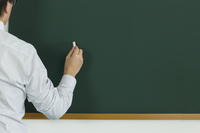 People who try to write something in chalk on a blackboard Stock photo [4410760] blackboard