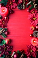 Red poinsettia and candle red wood background Stock photo [4638689] Poinsettia