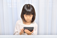 Girl playing in the tablet Stock photo [4963732] have