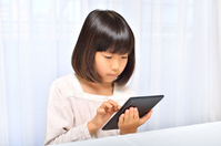Girl playing in the tablet Stock photo [4963733] have