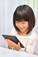 Girl playing in the tablet Stock photo [4963735] have