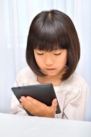 Girl playing in the tablet Stock photo [4963736] have