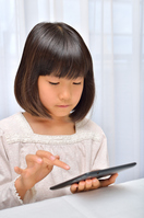 Girl playing in the tablet Stock photo [4963738] have