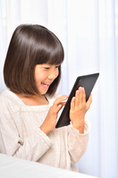 Girl playing in the tablet Stock photo [4963740] have