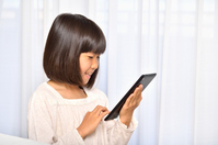 Girl playing in the tablet Stock photo [4963741] have