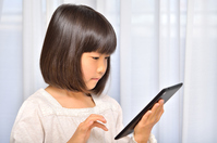 Girl playing in the tablet Stock photo [4963743] have