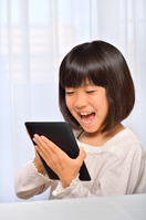 Girl playing in the tablet Stock photo [4963744] have