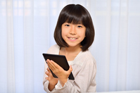 Girl playing in the tablet Stock photo [4963745] have