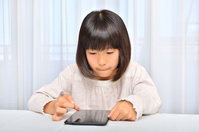Girl playing in the tablet Stock photo [4963747] have