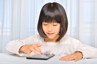 Girl playing in the tablet Stock photo [4963749] have
