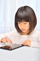 Girl playing in the tablet Stock photo [4963751] have