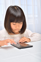 Girl playing in the tablet Stock photo [4963752] have